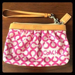 Cute pink and white coach wristlett purse